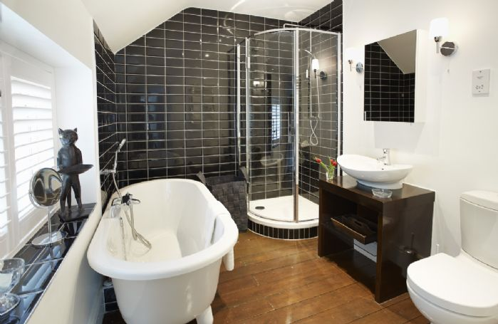 First floor: Family bathroom with roll top bath and walk in shower