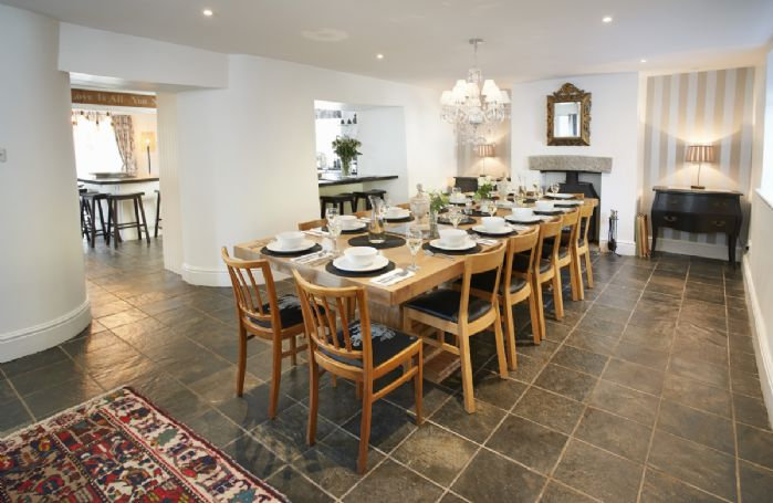 Ground floor: Dining room with wood burning stove and dining table seating 14
