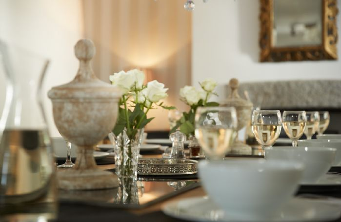 The large dining table seating 14 is perfectly suited for celebration meals with family and friends