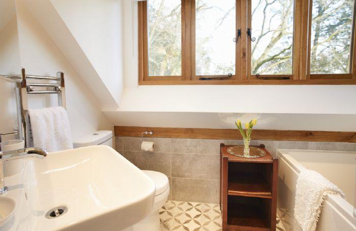 Littlepool: En-suite bathroom with overhead shower