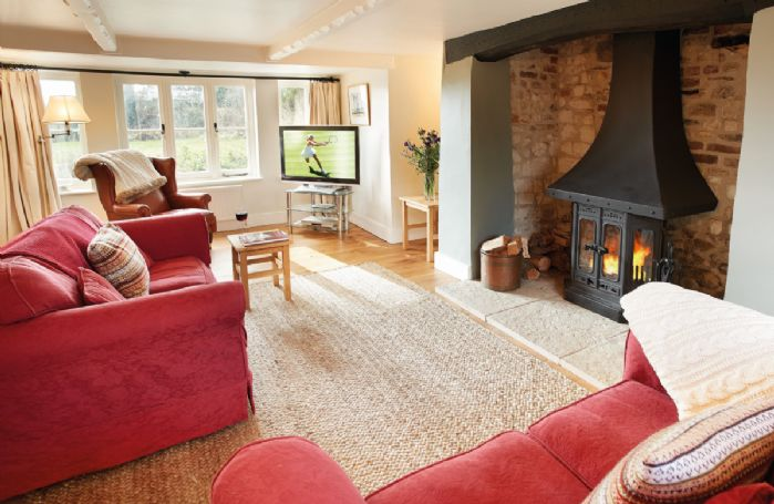 Ground floor: Sitting room with wooden burning stove