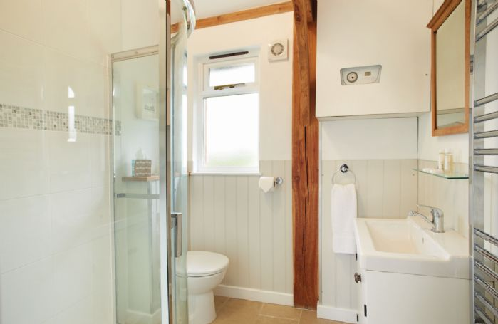 Ground floor:  Large shower room with overhead shower and handheld attachment.