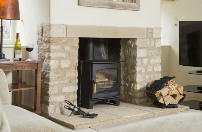 Ground floor: Sitting room with wood burner stove