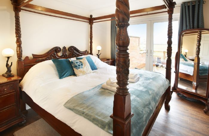 Ground floor: Master bedroom with four poster super-king bed