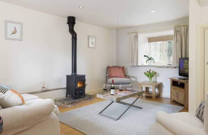 Ground floor: Sitting room with LPG fuelled stove