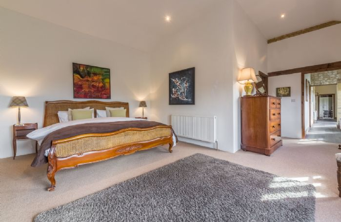 Ground floor: Master bedroom with 6' super king bed and en-suite bathroom