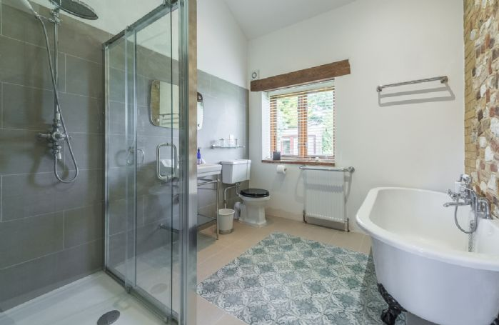 Ground floor: En-suite bathroom with roll top bath and separate walk in shower