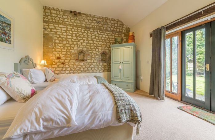 Ground floor: Bedroom with two 3' zip and link beds which can be configured as 6' super king bed on request and en-suite shower room