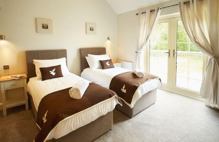 Ground floor: Twin bedroom with 3' beds and en-suite shower room