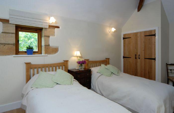 Ground floor: Twin bedroom with en-suite bathroom