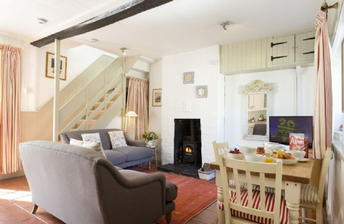 Ground floor: A small, cosy and compact open plan living area with wood burning stove
