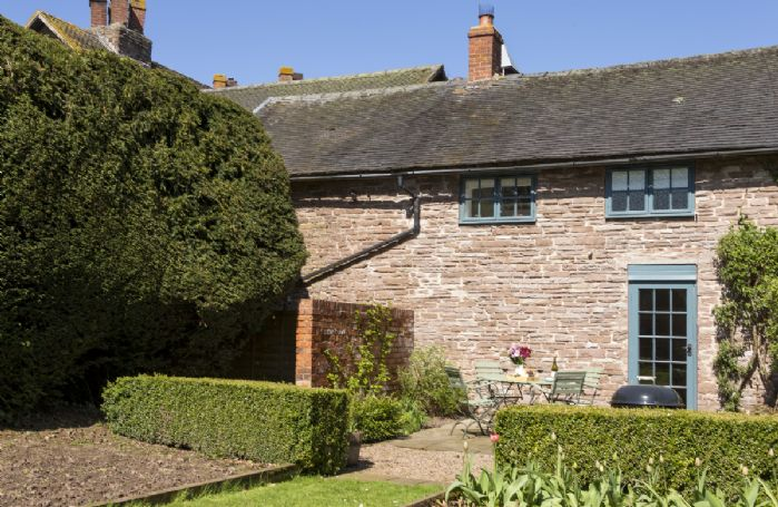 To the rear of Yewtree Cottage is an attractive patio and garden