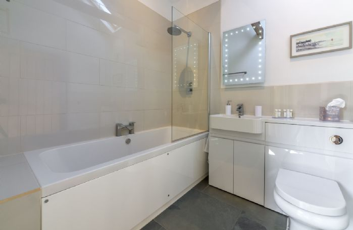 Ground floor: Bathroom with shower over