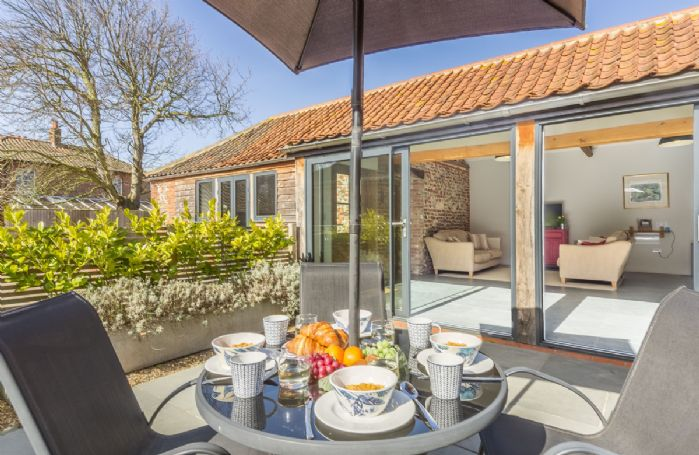 Sliding glass doors from sitting room lead onto a private, South facing courtyard