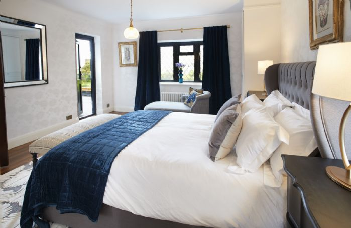 First floor: Master bedroom with en-suite and door leading to the terrace with sea views.