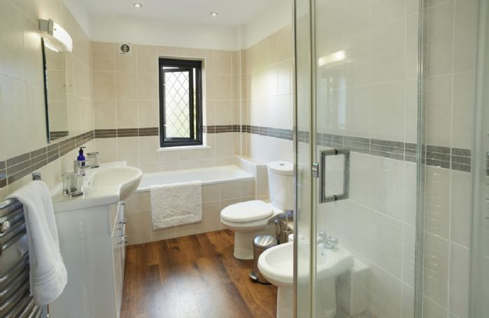 First floor: The master bedroom's en-suite features a bath and separate walk in shower