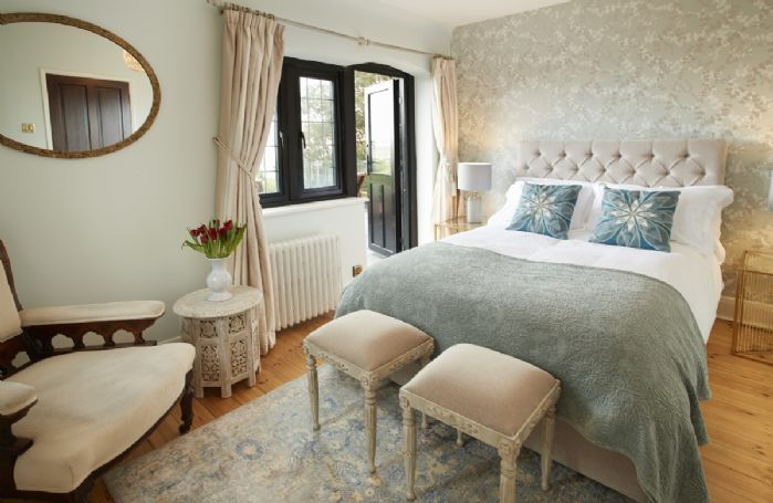 First floor: Second bedroom with door leading to the terrace with sea views.