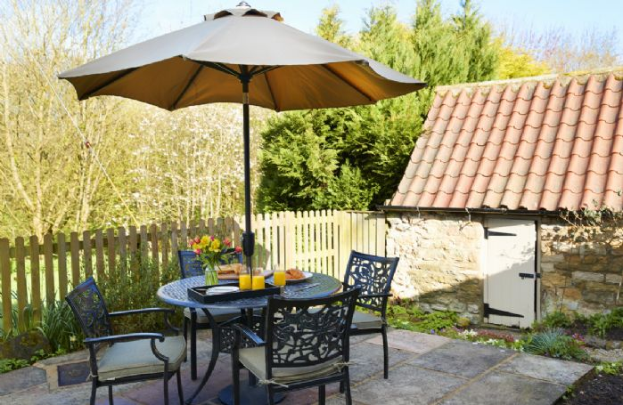Enjoy a leisurely breakfast on the private patio at the rear of the garden