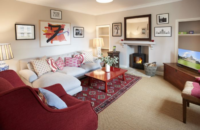 Ground Floor: Snug/TV room with wood burning stove, relax on the comfortable L-shaped sofa