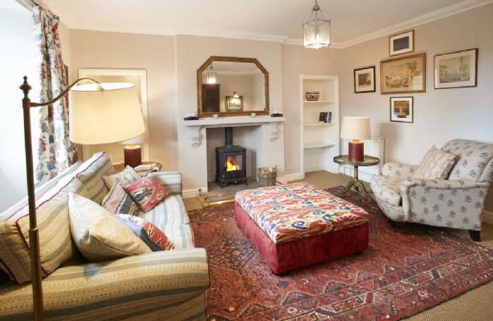 Ground Floor: Sitting room with wood burning stove and furnished with carefully chosen pieces from  Castle Howard itself