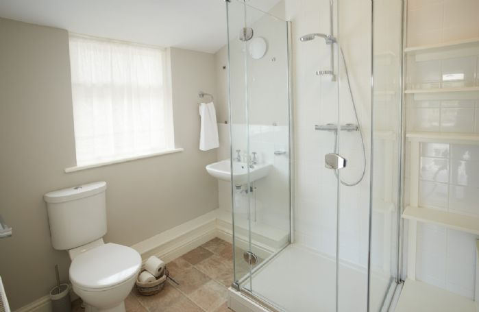 Ground Floor: Large shower and built in shelving unit