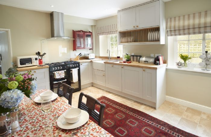 Ground Floor: Farmhouse kitchen with range cooker and belfast sink