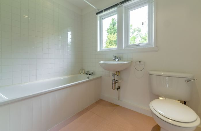 Ground floor: Family bathroom with bath and overhead shower