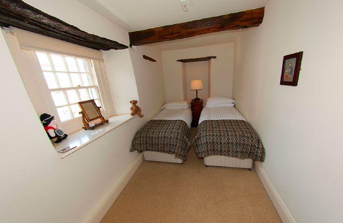 First floor: Small twin bedroom