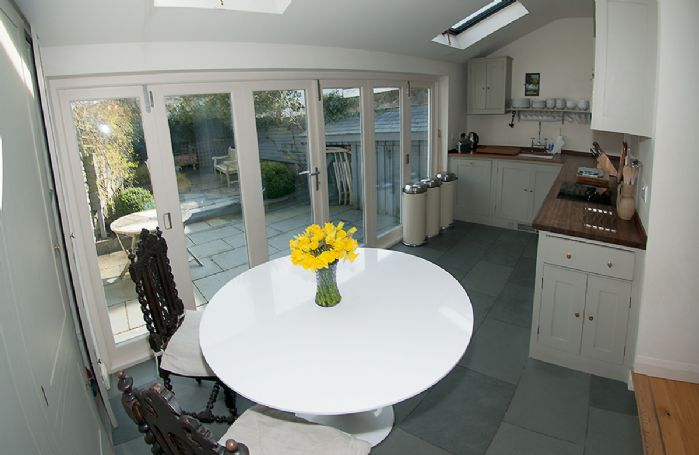 Ground floor:  Kitchen with contemporary folding doors leading into the courtyard garden
