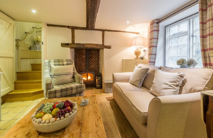 Ground floor:  Cosy sitting room with wood burning stove