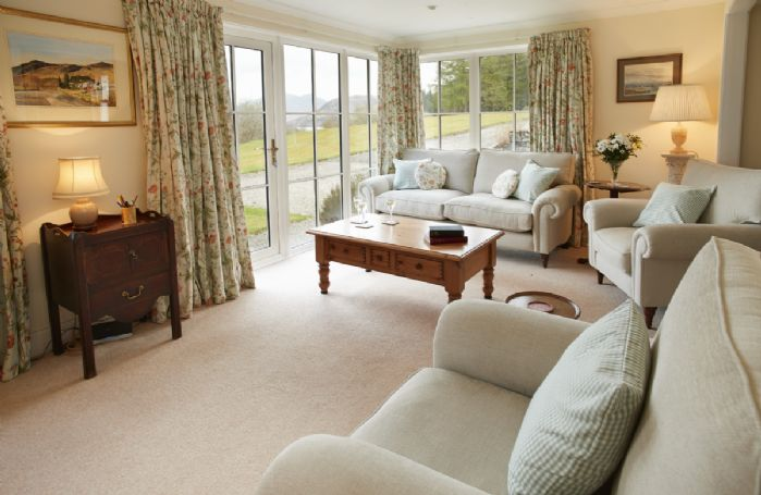 Ground floor: Sitting room with French windows onto the front garden and views of Loch Etive
