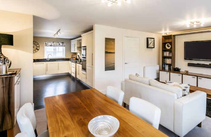 Ground floor: Open plan contemporary living/dining area leading from the kitchen