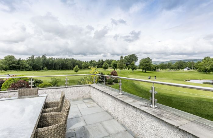 The Penthouse has a stunning roof terrace with views of the golf course and fells beyond
