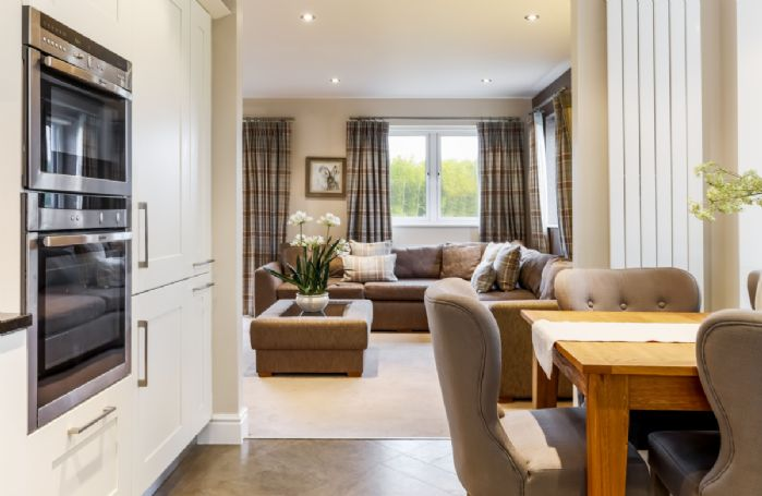 First floor: Open plan accommodation with sitting area, dining area and kitchen