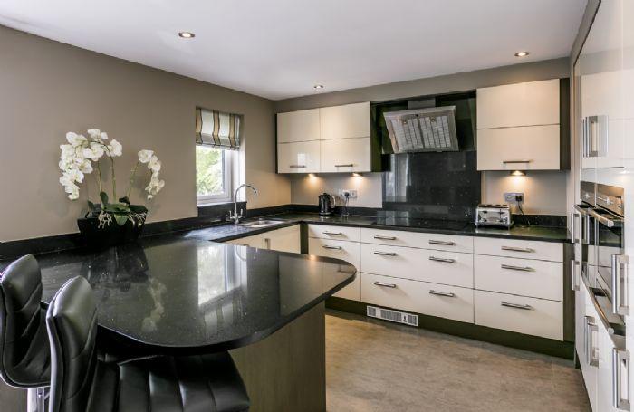 First floor: Open plan modern kitchen/dining area