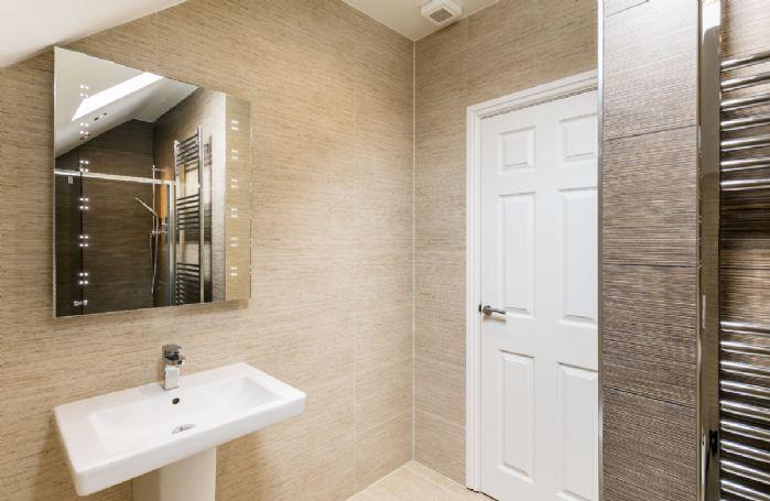Second floor: En-suite shower room.