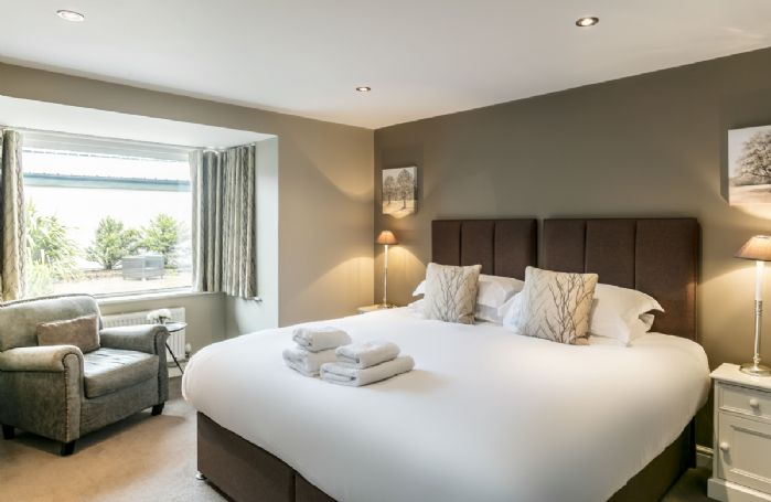 First floor: Bedroom with 6' super king bed that can be configured as twin beds on request