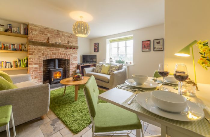 Ground floor: Sitting room with wood burning stove and dining table