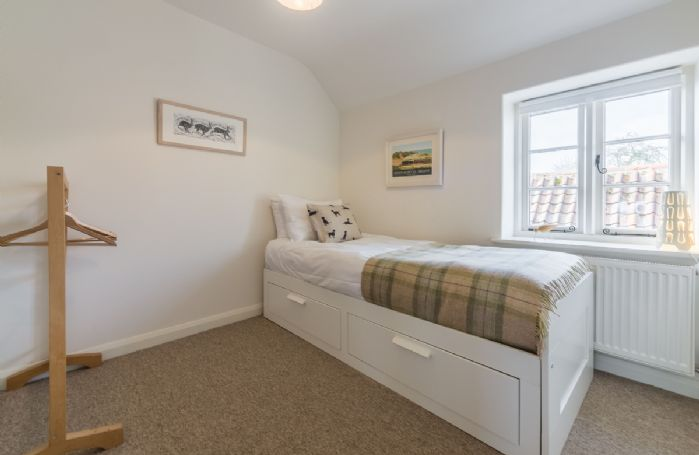 First floor: Bedroom with single bed and views to rear garden