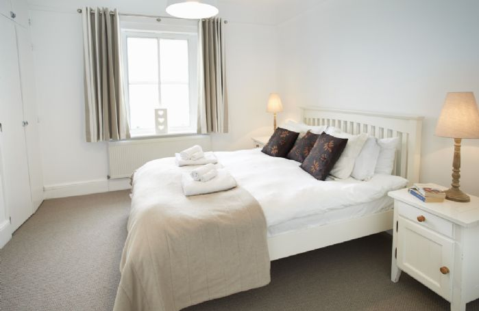 Ground floor: Double bedroom with 5' bed and sea views
