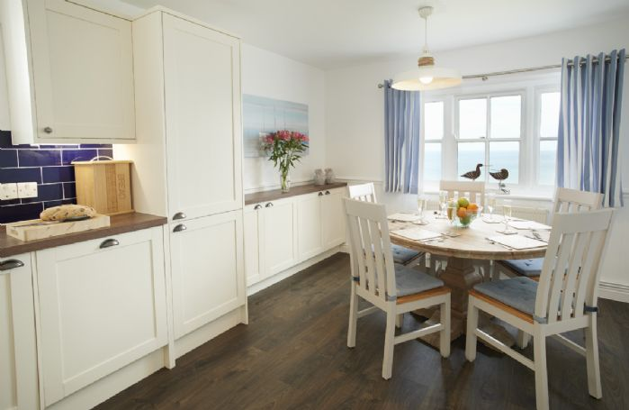 Ground floor: Kitchen with dining area which has sea views