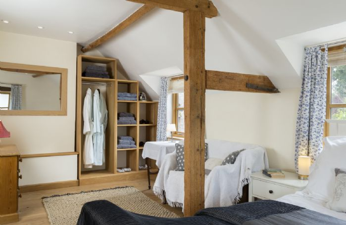 First floor: Galleried bedroom with double bed, sitting area and en-suite shower room