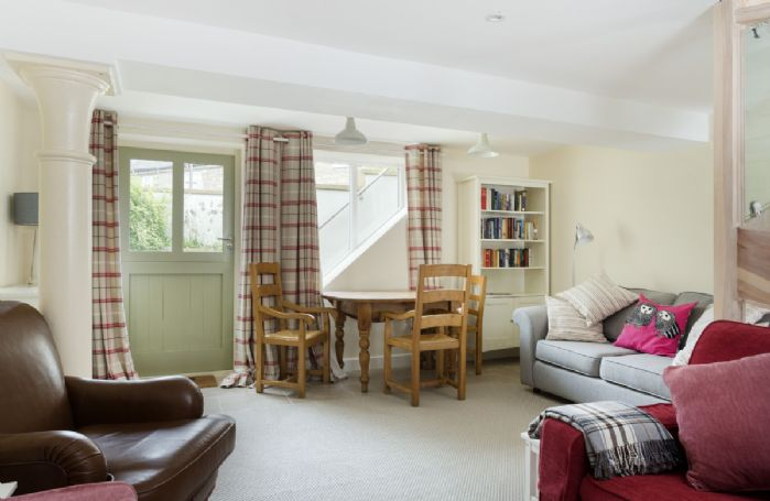 Lower ground: Sit and relax on these comfy sofas and chairs with door to front garden