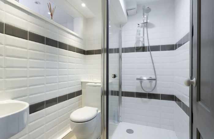 Lower ground:  Cloakroom with shower
