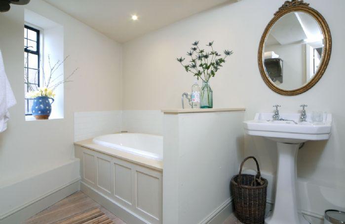 Ground floor: Bathroom with bath and shower attachment