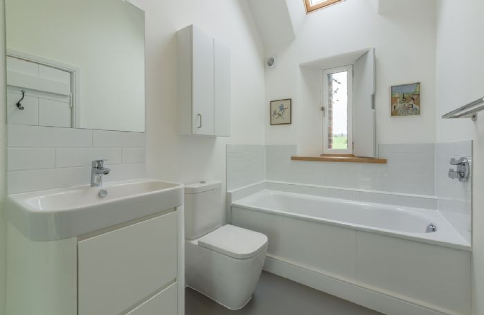Ground floor: Bathroom with bath and separate shower
