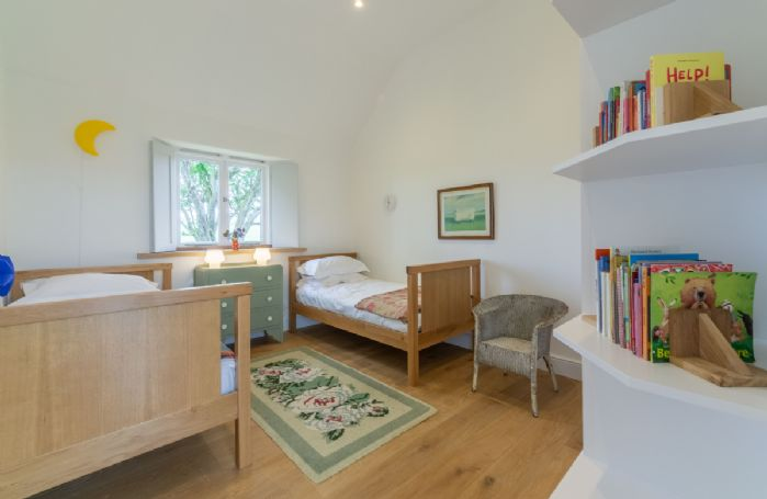 Ground floor:  Bedroom Four with twin beds
