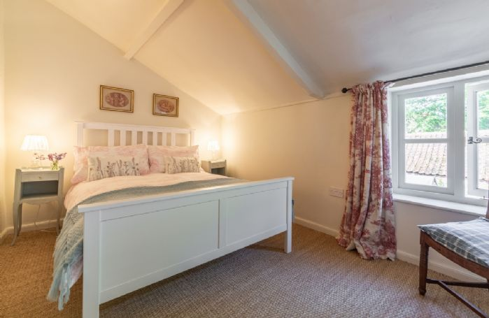First floor: Second bedroom overlooking the garden with 4'6 double bed