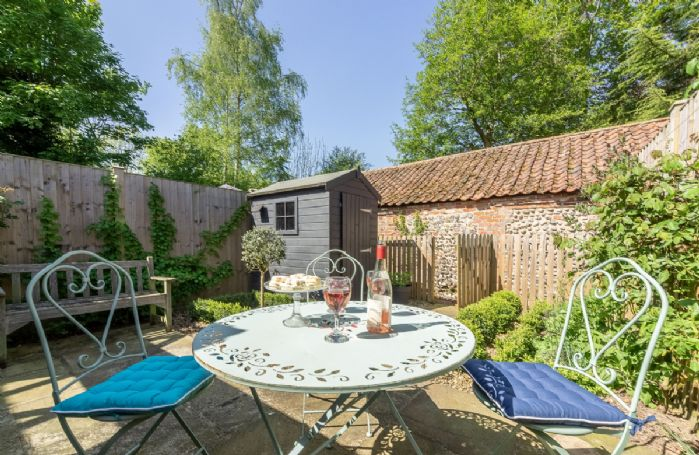 Enjoy the warmer months in the enclosed rear courtyard garden at Bridge Cottage