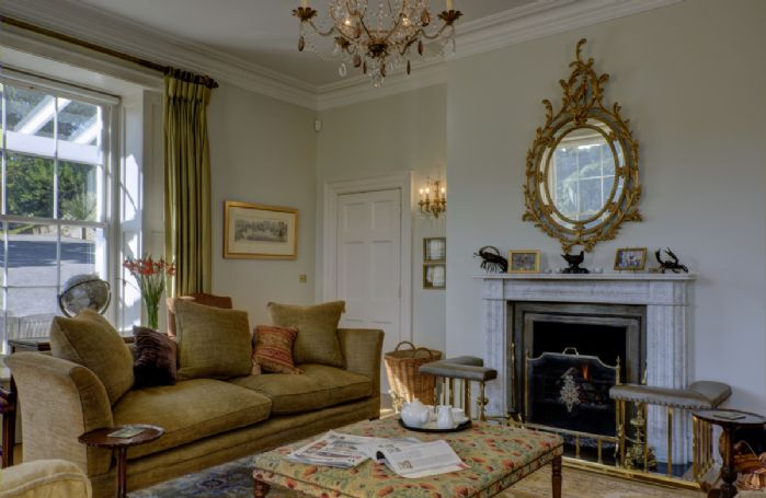 Ground Floor: Beautiful sitting room with open fire, a lovely place to sit and relax at any time of the day